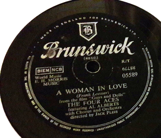 The Four Aces - A Woman in love - Brunswick - 05589