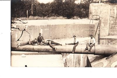SOLDIERS SITTING ON PIPELINE